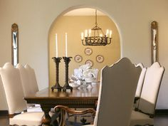 This beautiful and elegant dining room with Os de Mouton dining chairs, soft cream upholstery fabric and the neutral wall color displays my style of classic elegance.