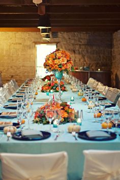 Family style tables with teal and oranges - love this color combo!
