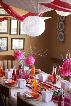 Asian Theme Party - interesting blend of Asian & Spanish items - notice Jarritos drinks and tissue flowers are Spanish.  Love the white umbrella
