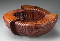 Noguchi Ranposai, Artist, Ruminations, Flower Basket, approx. 1998, bamboo (madake) and rattan  Selected techniques: thousand line construction, chrysanthemum base plaiting, H. 6 1/2 in x Diam. 15 in.  Lloyd Cotsen Japanese Bamboo Basket Collection,   Photograph by Kaz Tsuruta.