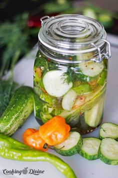 Homemade spicy pickles recipe made with habanero peppers. Make and jar your own pickles with this super simple recipe - be a hit at your next BBQ!