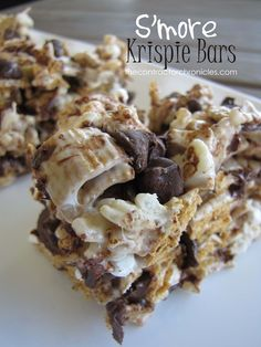 Delicious S'more Krispie Bars made with Rice Krispies, Golden Grahams, Marshmallow, Chocolate Chips and Marshmallow bites! I bet you can't eat just one!