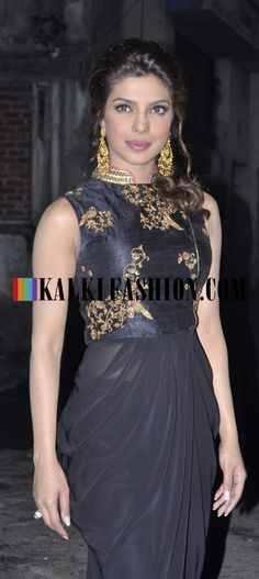 http://www.kalkifashion.com/ Priyanka Chopra looking stunning in a Tisha Saksena balck outfit with embroidered bodice on the set on Big Boss to promote her upcoming film Krish 3.
