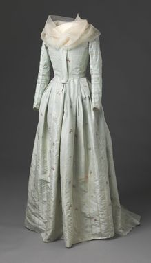 This is beautiful, and interesting.  It is dated as 1785-95, from Britain.  It looks like a gown in the front, but if you look at the back, it appears to be a pierrot with a matching petti...a petti that seems long for that particular style!