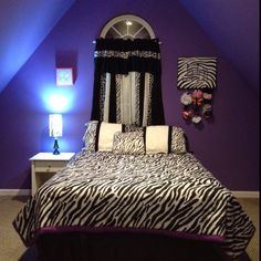 two of my favorite things for a room! Purple and zebra print. :D