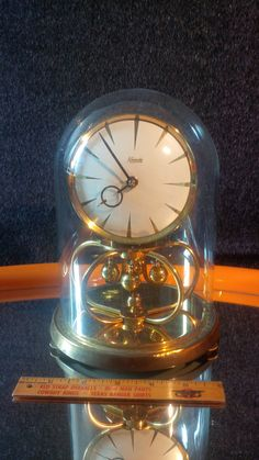 This beautiful torsion pendulum clock in glass casing is by Kieninger &… Pendulum Clock, Clocks, 1970s, Germany, Cool Stuff, Classic, How To Make, Etsy, Vintage