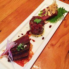 A trio of #tuna - scallion topped tuna #tataki over housemade #kimchi; sesame-scallion tuna #poke; and sliced tuna #sashimi with #avocado. #yum #nom #delicious #eeeeeats #sushi #baltimore by eunibug33