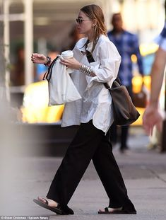 Billowy: Ashley Olsen, 31, made a quirky sartorial statement as she stepped out in an extr...