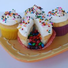 Pinata Cupcakes | •Bake cupcakes •Cut center out •Fill with candies •Cut the top of the cutout portion and cover candy •Cover with icing and sprinkles.