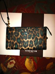 'Coach SIS Ocelot Jade Park Zippy Wallet' is going up for auction at  5pm Wed, Jan 8 with a starting bid of $50.