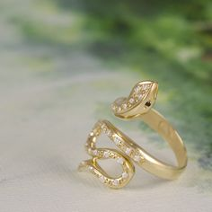 """Gold Ring from snakes collection.In Ancient Crete,where """"Evans Snake Goddess""""was found ,snakes were worshipped as guardians of her mysteries of birth and regeneration. 14k Gold Ring, Gold Rings, Snake Goddess, Gold Jewelry, Fine Jewelry, Snake Ring, Ancient Greek, Stone Rings, Wedding Rings"""
