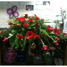 Casket piece of roses, lilies, hypericum berries and more.