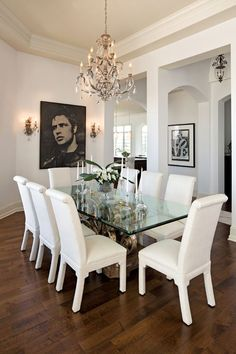 Indianapolis Monthly's 2012 Dream Home: An exclusive look inside the city's premier show home. A crisp color palette of mostly white-and-cream walls and furniture—with splashes of color throughout—complements the builder's architectural design. #diningroom #chandelier #glasstable #table