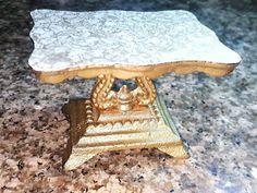 Antique Victorian Style Heavy Brass Pedestal Table Display MADE IN TAIWAN  SIZE: 4 X 2.75 X 2.5 Sturdy and Durable  Vintage Ornate faux marble Brass trivet tripod base for multiple uses:  Trivet Stand Dish Soap Plant Stand Kettle Table Jewelry Display Photo Prop Photo Display Dollhouse Miniature Side or Center Table Regal Small Dollhouse Side Table GREAT VINTAGE CONDITION