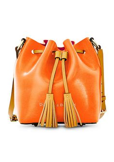Dooney & Bourke Serena Small Drawstring Crossbody -  The Serena Crossbody captures the timeless appeal of a drawstring bag in beautiful, fine-grained leather. The bag's resin-coated interior adds a contrasting pop of color and the adjustable strap provides a personal fit. With compact size and minimalist style, this crossbody is both chic and practical. Plus, inside there's a bonus zip pouch!