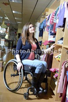 Pregnant Mom in wheelchair shopping for new baby. >>> See it. Believe it. Do it. Watch thousands of spinal cord injury videos at SPINALpedia.com