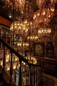The staircase leading up to the men's section is a collector's dream. Filled with antique brass utensils, rare Tanjore paintings and art from The Sabyasachi Art Foundation, it creates a truly spectacular experience. Photography by S Thiru Antique Chandelier, Glass Chandelier, Marquee Lights, Ceiling Lights, Antique Chest, Antique Brass, Asian Paints, Indian Interiors, Tanjore Painting