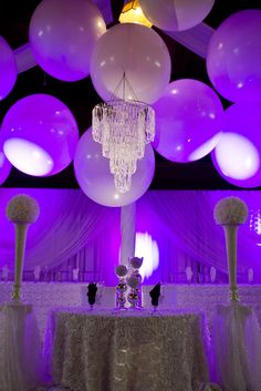 Who doesn't love a little fun?  This bride and groom united large balloons, sparkly loop chandeliers, and gorgeous fabrics to tie their big day together!