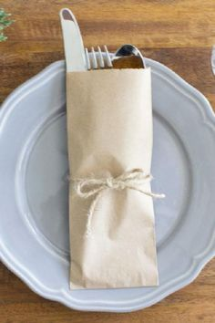 Cutlery should also be individually packed so that it's protected. These paper bags are a simple solution that solves the problem. Add a fun sticker or ribbon to match your theme, and you're ready! See more party ideas and share yours at CatchMyParty.com #catchmyparty #partyideas #socialdistancing #socialdistancingparty #socialdistancingpartyfoodideas