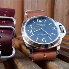 Panerai Watch, for the man - this might sound silly, but when i look at this watch, my imagination takes off, picturing a well-dressed and well-traveled gentleman from another era.  i just love the classic simplicity of this timepiece and actually prefer it.  i'd totally talk to a dude who wore a watch like this...exquisite taste