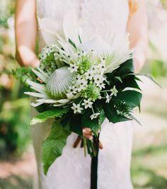 STUNNING Bridal Bouquet Showcasing: Green/White King Protea, Star Of Bethlehem, Green Monstera, Green Maiden Hair Fern, Green Leather Leaf Fern + Additional Tropical Green Foliage ••••