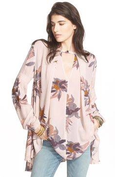Free shipping and returns on Free People 'Tree Swing' High/Low Top at Nordstrom.com. A colorful floral print brightens up a long-sleeve swing top shaped for a voluminous fit. The back panel is gathered at the yoke for a cascading finish.