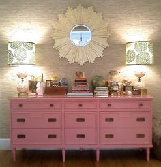 Pink bamboo dresser with the grey lamps for a little girl's room.