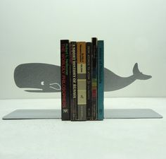 Whale bookends by Knob Creek Metal Arts.  I think I understand the reference, and ironically, this set costs 42 bucks.