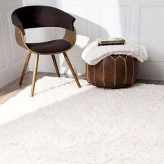 Plush Shag Rug and a brown leather moroccan pouf