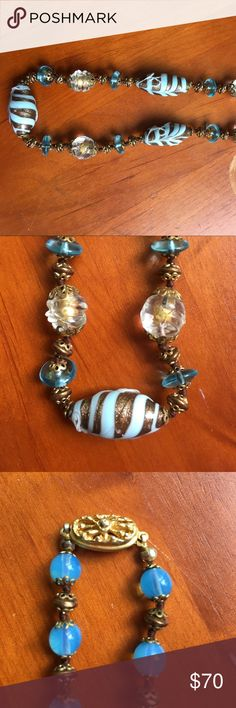 Vintage Venetian glass necklace from Italy. This vintage Venetian glass necklace went flat is about 23 inches.  Unclasped it is approximately 11 inches. Amazing quality in these handblown beads. Goldtone clasp. From Venice Italy. Venetian glass Jewelry Necklaces