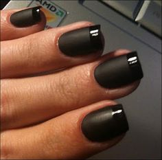 Black matte manicure with glossy black funky French tips.