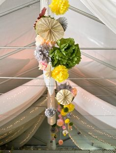 Paper pom-poms and lights hang from a tented wedding reception. Tent Decorations, Wedding Decorations, Prom Decor, Paper Bouquet, Ceiling Decor, Colorful Candy, Farm Wedding, Paper Flowers, Hanging Flowers