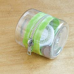 Upcycle it! Plastic-Bottle Zipper Container  2 container bottoms 1 zipper Hot glue & gun