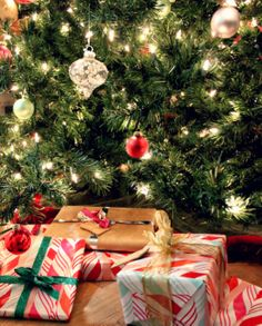 Presents under the tree wrapped with glitter & metallic ribbons // La Petite Fashionista http://lapetitefashionista.blogspot.com/2013/12/holly-jolly-sparkly-christmas-decor.html