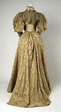 Dress (back view) Date: 1894–95 Culture: French Medium: cotton, silk Accession Number: 35.134.5