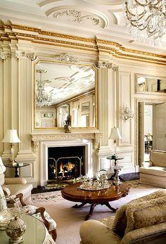 Chandelier + walls + furniture + fireplace