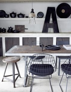 Black and white kitchen with industrial stool and chairs