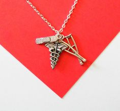 Support Independent Artists--------- Silver Medical, Nurse, Doctor Necklace with… Cute Necklace, Lariat Necklace, Athletic Trainer, Sports Medicine, Nurse Gifts, Antique Silver, Handmade Jewelry, Crutches, Pendant