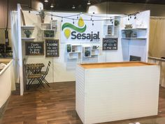 Condit Exhibits designed and built this farm-style trade show booth for Sesajal at the Natural Products Expo West show in 2017. White beadboard, wood floating shelves, string lights and chalkboard signs gave the exhibit a charming, rustic style.