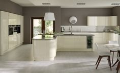 The ultimate contemporary style statement. High gloss, graceful curves complimented with ever stylish grey colour accents. The epitome of sophistication. Love it. nestkitchens.co.uk