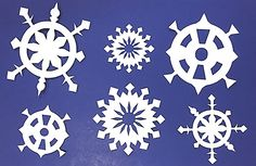 Decorate for the holidays and the winter ahead with these dainty paper snowflakes! (Learn all about symmetry too!)