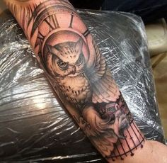 Owls and Clock Tattoo. More via http://forcreativejuice.com/attractive-owl-tattoo-ideas/