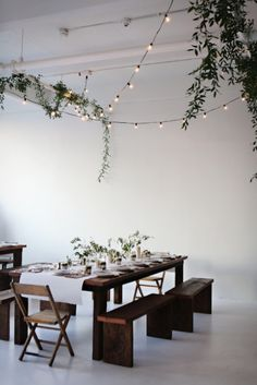 Graceful and simple dining area. Natural light with enhancement from small lights on a string. Plain furniture with clean lines. Graceful greenery, not too much of it. Restful and certainly good for digestion!