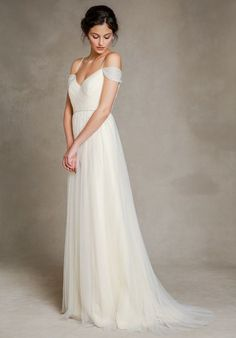 Ivory tulle A-line crisscross sweetheart neckline wedding dress with delicate spaghetti straps.
