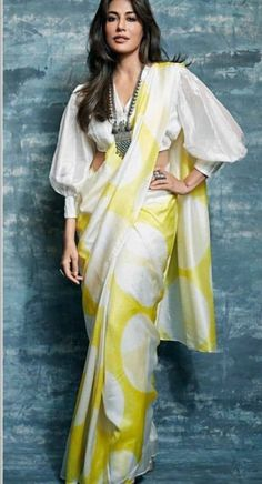 5 Blouse Styles Which Are Worth Having In Your Wardrobe – Fashion in India – Threads Modern blouses are experimental and also look chic. Discover These Latest Fashion Blouse Styles Which Are Worth Having In Your Wardrobe At Threads. Indian Blouse Designs, Saree Blouse Neck Designs, Fancy Blouse Designs, Saree Blouse Patterns, Dress Designs, Trendy Sarees, Stylish Sarees, Blouses For Sarees, Sari Bluse