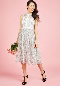 <p>By combining your bright personality with the details of this white dress, you create a truly spectacular look. The lace neckline and shoulders, architectural piping, and black-outlined overlay of this ModCloth-exclusive midi are pretty on their own, but with your company, they become absolutely breathtaking!</p>