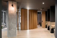 "Slack branding is kept minimal, with one company logo branded into wood panels by the lift and another lettered in black behind the reception. ""The fit-out expresses the company's desired aesthetic rather than an explicit use of corporate colours and logos,"" said ODOS Architects."