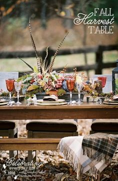 Fall harvest table arrangement, love the quail feathers