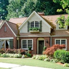 Image result for red orange brick with charcoal mansard roof and charcoal trim