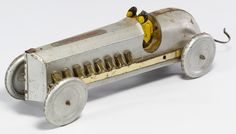 """Lot 469: Buffalo """"Silver-Dash"""" Tin Race Car; 1925, marked on the front hood, having two tin drivers"""